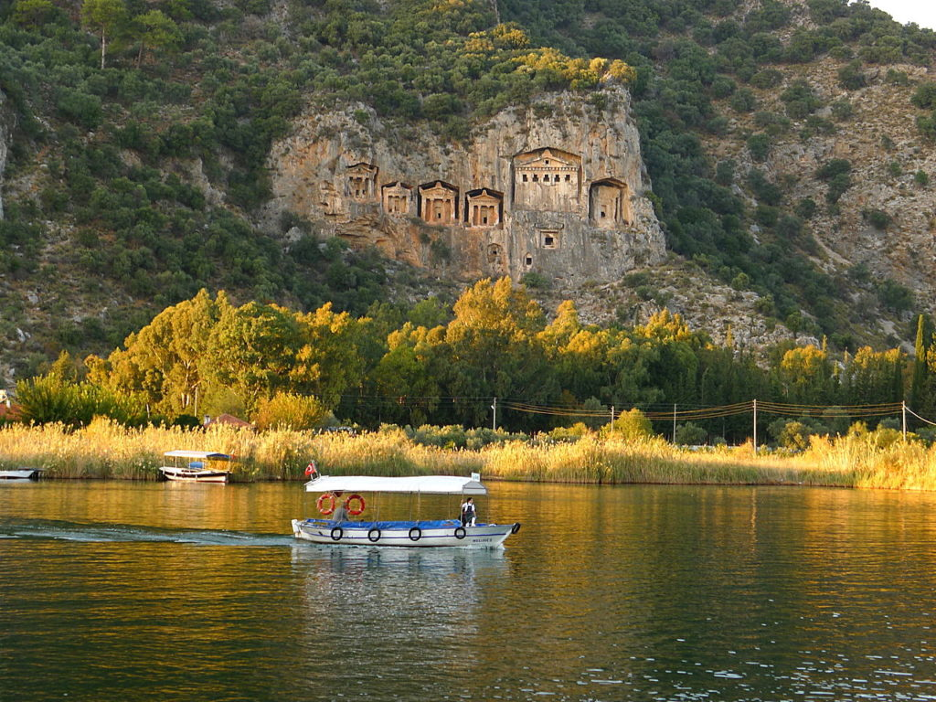Dalyan river boat King Rock Tombs in the background