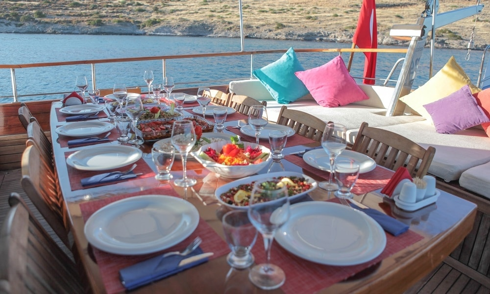 blue cruise dining in a quiet, private bay